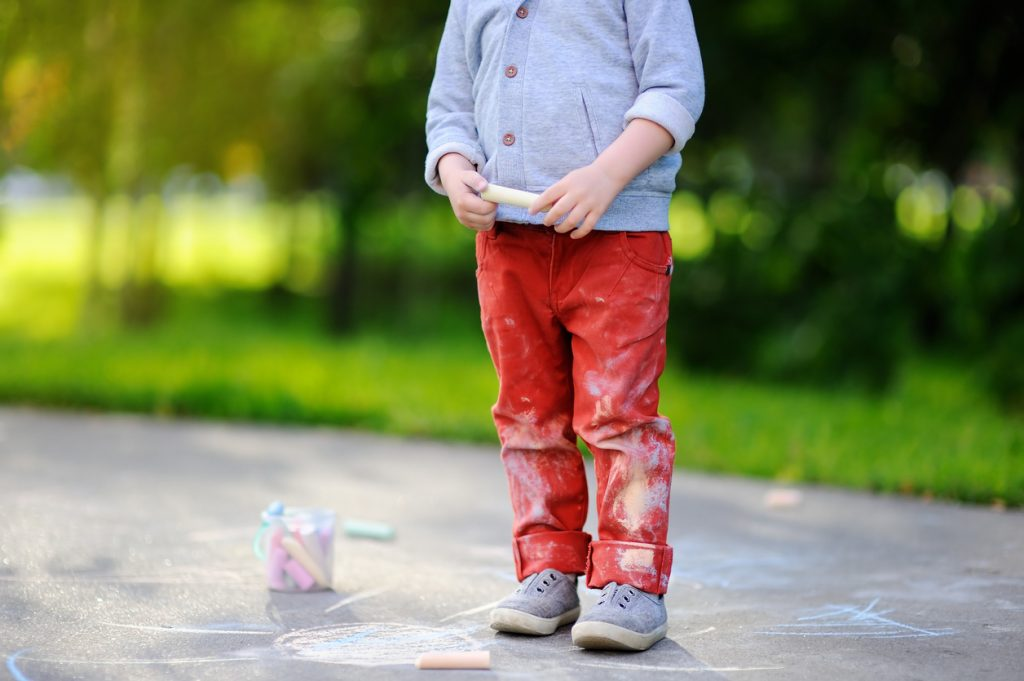 Toddler with stained paints