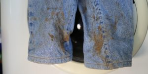 Stained Jeans Before Laundry